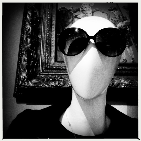 Mannequin's / gaze through dark glasses / disdainful.