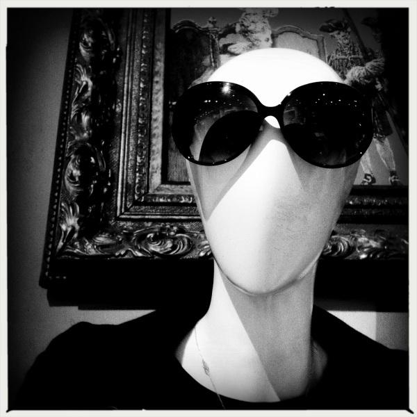 Mannequin's / gaze through dark glasses / disdainful.
