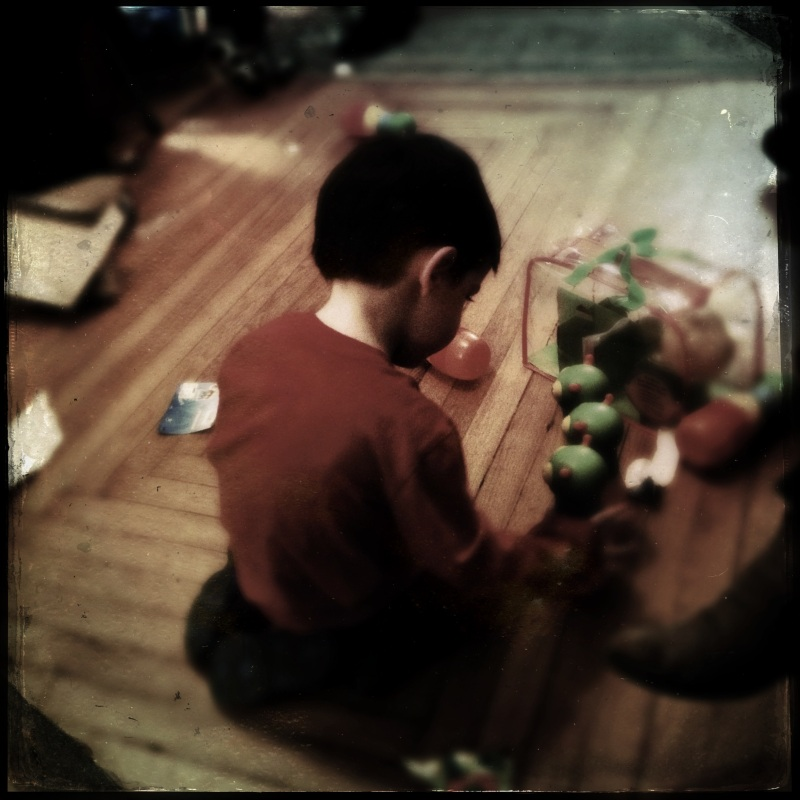 Loved ones exchange gifts / mindfully, thankful we are / here to exchange them. Haikumages