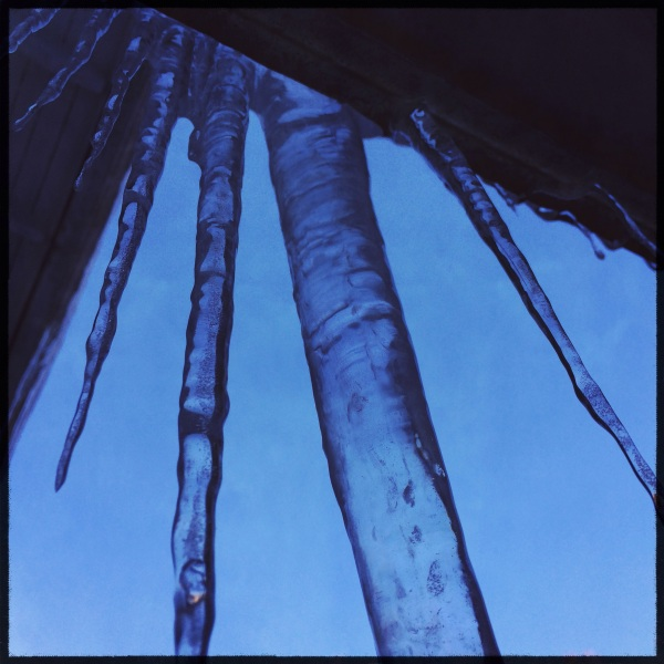 Lovely icicles / remind us the house is not / well insulated. Haikumages