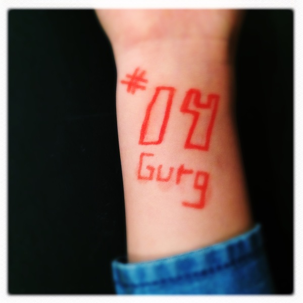 Expressing their grief / little wrists tattooed with his / number and nickname. | Haikumages