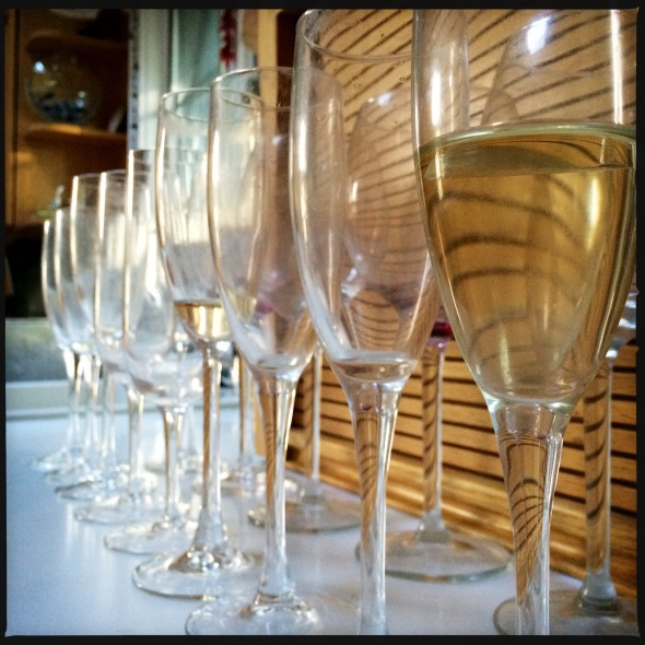 Champagne aftermath / a row of empty glasses / one glass left half full. / haikumages