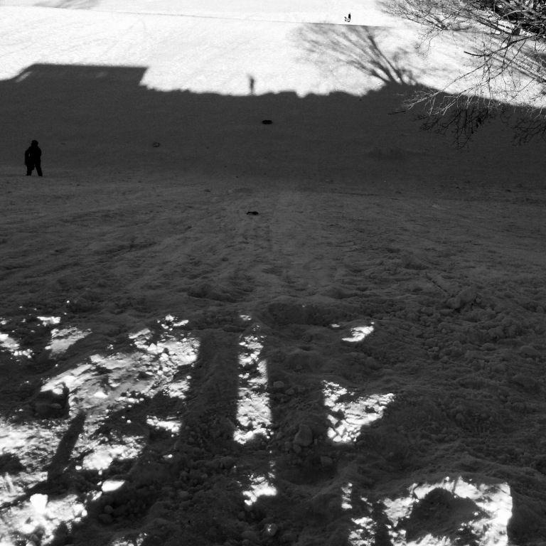 On the mountaintop / my shadow starts at the top / ends at the bottom. // haikumages