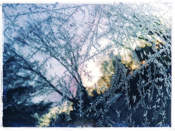 Sunrise viewed / through the ice crystals / on my car. // haikumages - haiku - micropoetry