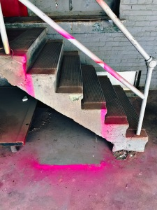 A perimeter stain / where some thing was painted pink / then quickly removed. // micropoetry - haiku - haikumages
